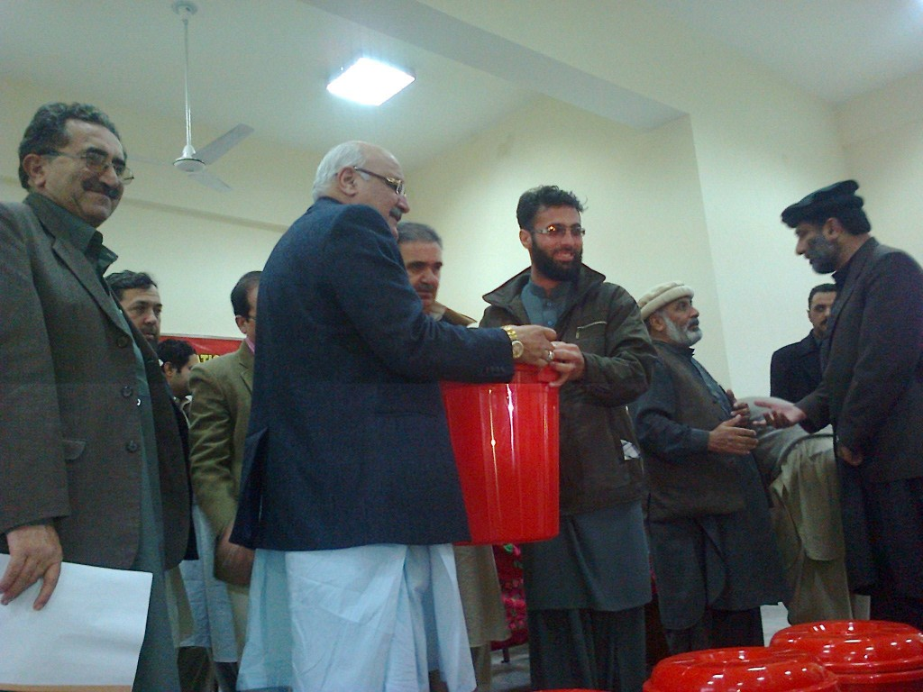 Mian Iftikhar Hussain is distributing water filtration kits in flood effectees